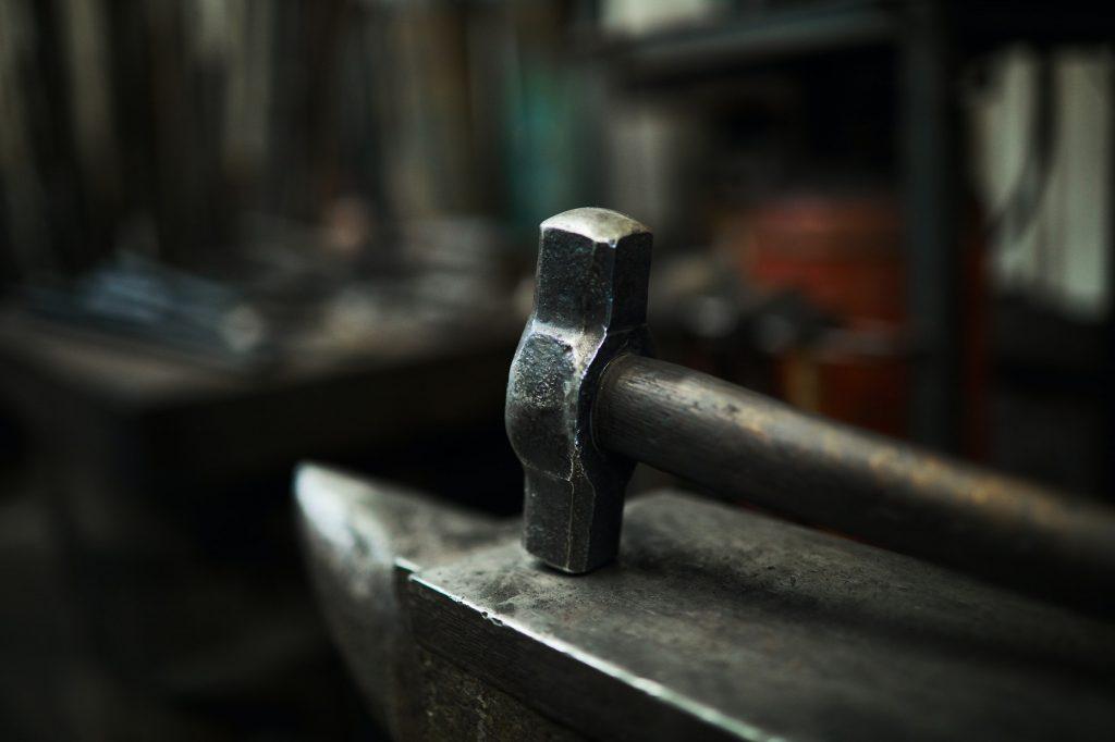 Steel hammer on anvil