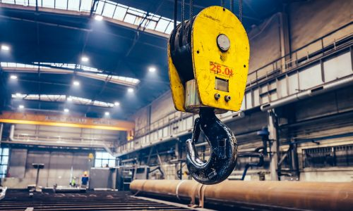 Crane hook in a big factory. Shipyard industry